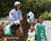 Skip the Act (FL) heads to the post parade with jockey Jose Rodriguez